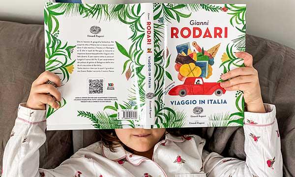 bambina legge Gianni Rodari